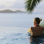 beautiful woman in a infinity pool jacuzzi at the Caribbean resort spa